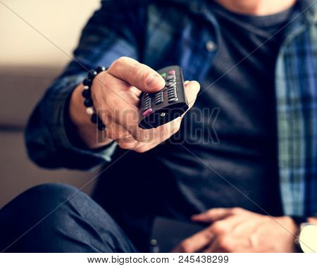 Caucasian man using tv remote controller