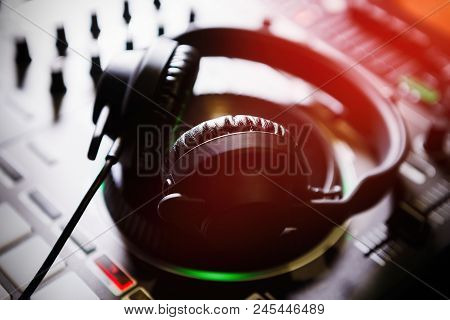 Professional Dj Sound Mixer And Headphones With Music