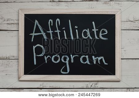 Affiliate Program Concept. Affiliate Marketing. Blackboard With Handwritten Text, Top View