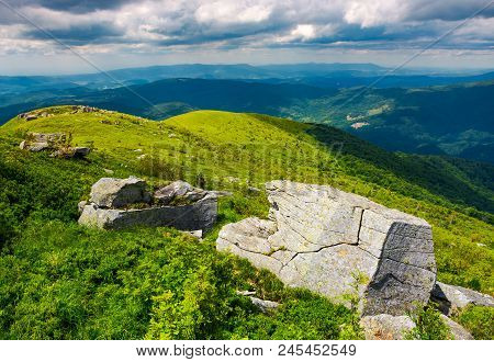 Boulders On Grassy Hills. Beautiful Mountainous Landscape. Distant Mountain Under The Cloudy Sky. Vi