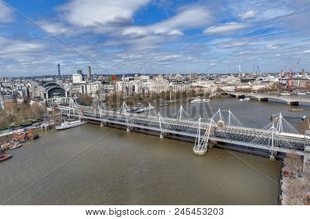 Aerial View Of Hungerford Bridge, A Steel Truss Railway Bridge, Flanked By The Golden Jubilee Bridge
