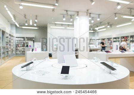 Showcase With Smartphones In The Modern Electronics Store. Buy A Mobile Phone. Many Smartphones On T
