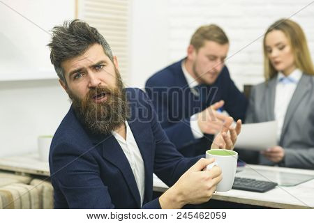 Business Partners Or Businessman At Meeting, Office Background. Negotiations Concept. Man With Beard