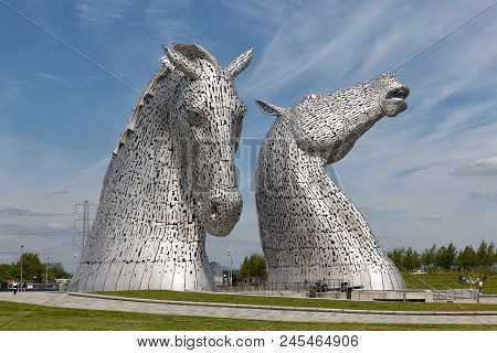 Falkirk, Scotland - May 19, 2018: People Walking Around The Kelpies, Famous Sculptures Of Horse Head