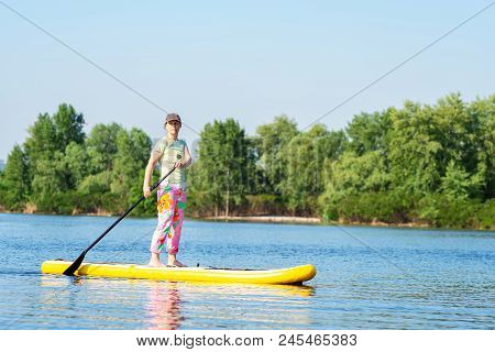 Adult Woman Is Floating On A Sup Board On Sunny Morning. Stand Up Paddle Boarding - Awesome Active R