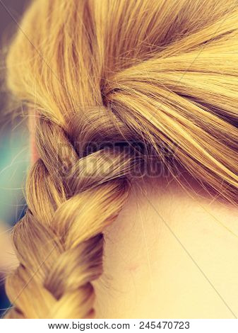 Fancy Trendy Blond Hairstyle Ideas Concept. Closeup Of Woman Blonde Braided Hair.
