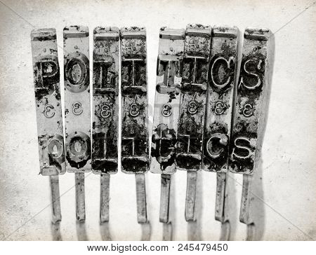 The word  POLITICS with old typewriter hammers macro image on old paper