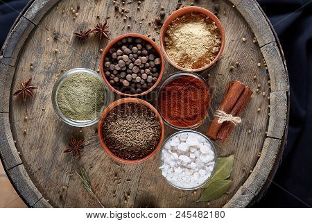 Spices In Ceramic Bowls On The Top Of Wooden Barrel, Close-up, Selective Focus, Vertical. Aromatic I