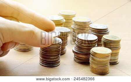 Hand Use Coins Of Thailand With Investment And Saving For Financial Investment Concept.