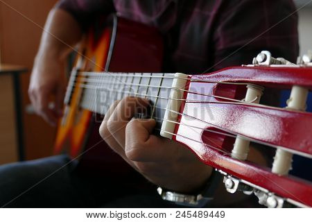 A Musician Plays A Solo Guitar, Man Playing Guitar Guitar Playing Close Fingers And Strings.