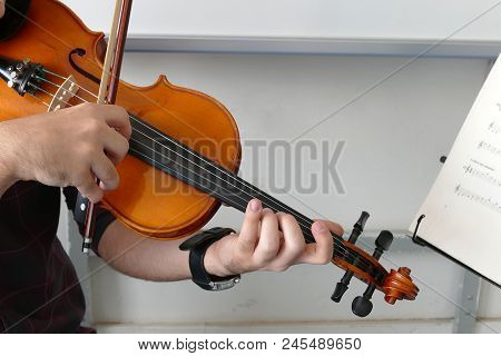 Violinist Playing The Violin At The School, Teaches Notes,classic Turkish Music.close-up Of Musician