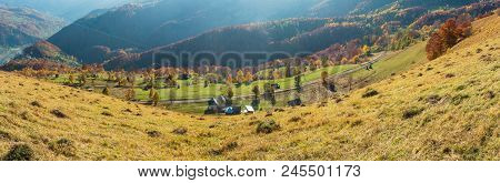 Dirty Secondary Road To Mountain Pass In Autumn Carpathian Mountains And Multicolored  Trees On Slop