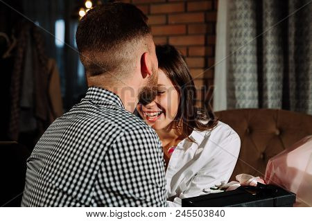 A Couple Dinners In A Restaurant A Man Kisses A Woman, Romantic Young Couple At Restaurant