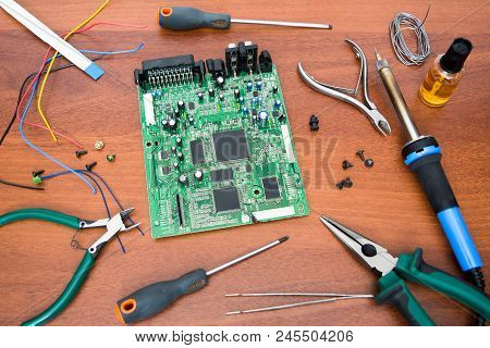 Electronic System Board With Microcircuits And Electronic Components. Necessary Tools For Repair. So