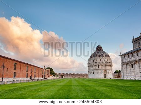 Piazza dei Miracoli (Square of Miracles) or Piazza del Duomo (Cathedral Square) with Pisa Baptistery and Pisa Cathedral in the morning light, Pisa, Tuscany, Italy