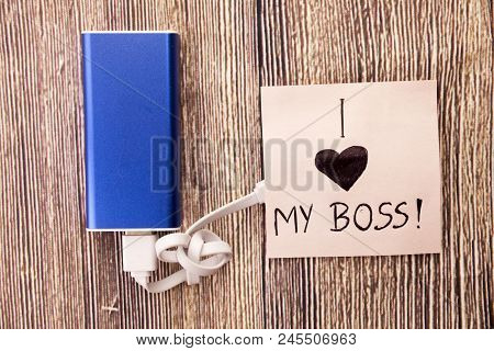Power Bank With A Piece Of Paper Around, Having Words I Love My Boss Is Present.love For An Officer,