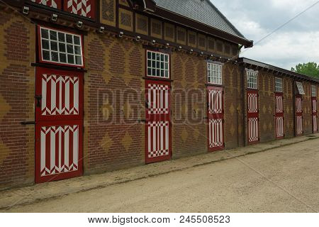 Red And White Decorated Doors Of The Stables Of De Haar Castle. The Red And White Are The Colors Of