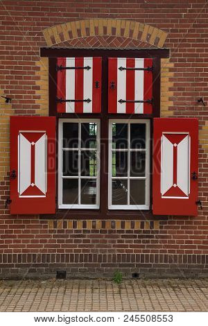 Red And White Decorations On The Doors And Window Shutters Of De Haar Castle. The Colors Are Derived