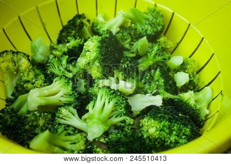 Healthy Food Concept With Green Broccoli Vegetables. Top View Of Plastic Bowl With Vegetables. Full