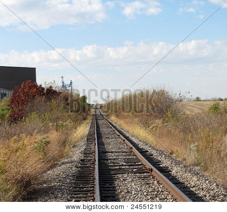 Rails leading to factory