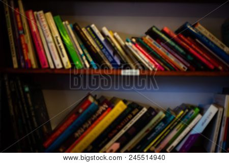 Stack Of Books On The Shelves. Learning Concept With Library Books On The Shelves. School Concept Wi