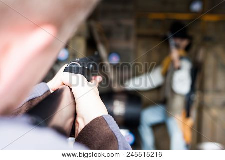 First Person Shooter Aiming In The Target. Military Concept With Rifle And Shooting Man. Shooting Wi