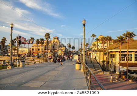 Huntington Beach, Ca - April 12, 2011 - People Walk Down The Pier In Huntington Beach, California