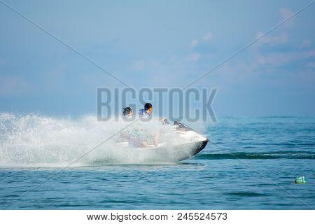Man And Women Rideing Jetski In The Sea