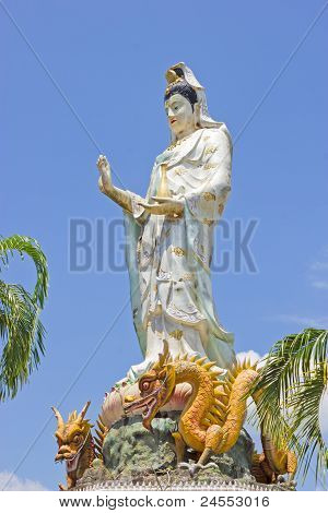 Kuan Yin standing on a lotus and two dragons poster