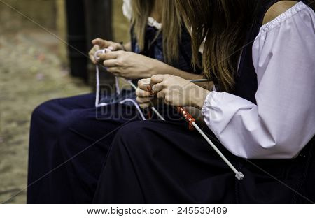Young Woman Knitting Clothes Wool, Detail Of Old Tradition To Make Clothes