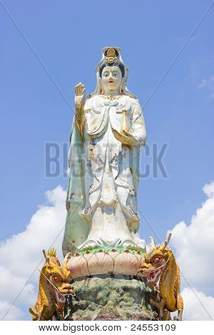 Kuan Yin with two dragons on a blue sky poster