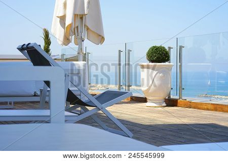 Interior Of A Large Hotel Balcony, Villas. Beautiful Balcony With White Divans. White Interior Conce