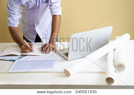 Architect Man Working With Laptop And Blueprints, Engineer Inspection In Workplace For Architectural
