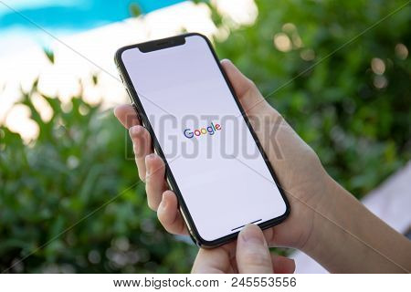 Koh Samui, Thailand - March 21, 2018: Woman Holding Iphone X With Social Networking Service Google O