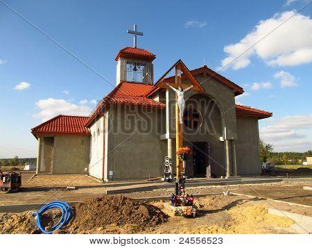 building Catholic chapel in Dyrdy parish Miotek in Poland poster