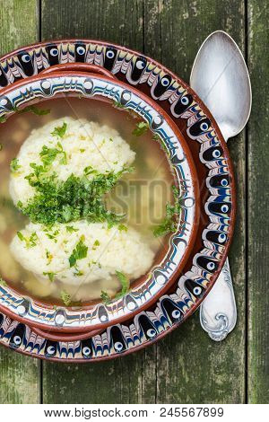 Plate With Traditional Dumpling Chicken Soup Decorated With Parsley