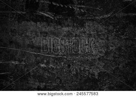 Black Rough Concrete Wall. Dark Gray Cement Surface Texture. Gloomy Grunge Background