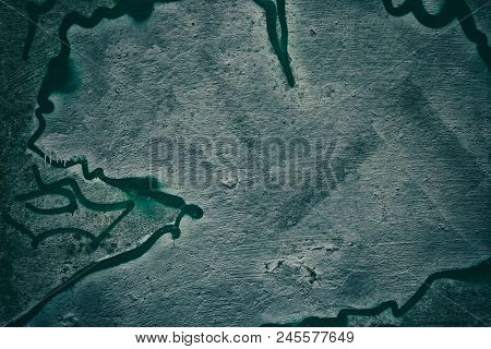 Dark Grunge Background. Rough Concrete Wall With Abstract Spray Paint
