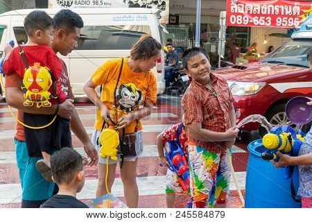 Songkhla, Thailand, Apr. 12, 2018 : The Tourists Shooting Water Guns And Having Fun At Midnight Song
