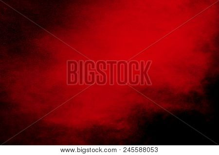 Abstract Explosion Of Red Dust  On Black Background. Abstract Red Powder Splatter On Dark  Backgroun