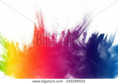 Multi color powder explosion on white background. Bizarre forms of  colorful dust particles splash on dark background. poster