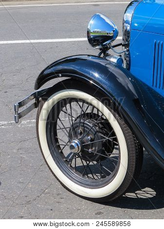 Old Blue Classic Car, Wheel Detail And Mudguards And Chrome In Sunny Day.