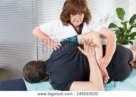 Man Having Chiropractic Back Adjustment. Osteopathy, Physiotherapy, Sport Injury Rehabilitation Conc