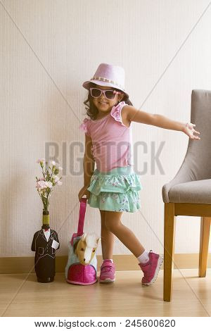 Little Girl Posing Tenderly With Sunglasses Pink