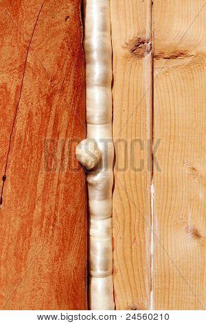Polyurethane foam seals gap in wood construction