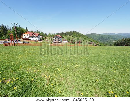 House At Green Landscapes Of Grassy Terrain And Forest At Beskid Mountains Range In European Salmopo
