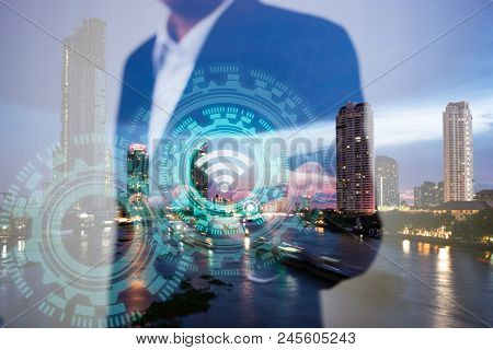 Double Exposure Of Business, Technology And Internet Connection Concept. Businessman Using Icon Wifi