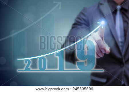 Business Man Point Hand On The Top Of Arrow Graph With High Rate Of Growth. The Success And Growing
