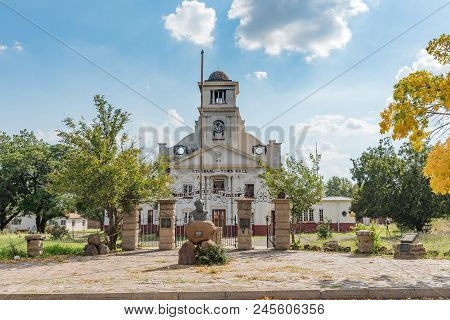 Wepener, South Africa - April 1, 2018: The Ruin Of The Burned Down Town Hall And A Monument For Louw