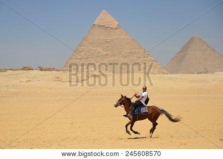 Cairo /Egypt - APRIL 03 2016: Tourists and  Giza Pyramids - Cairo, Egypt